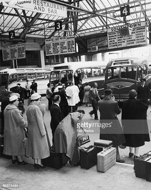 Holiday makers waiting at Victoria Coach Station London for coaches to the seaside 20th July 1957 The fine weather has left coach companies...