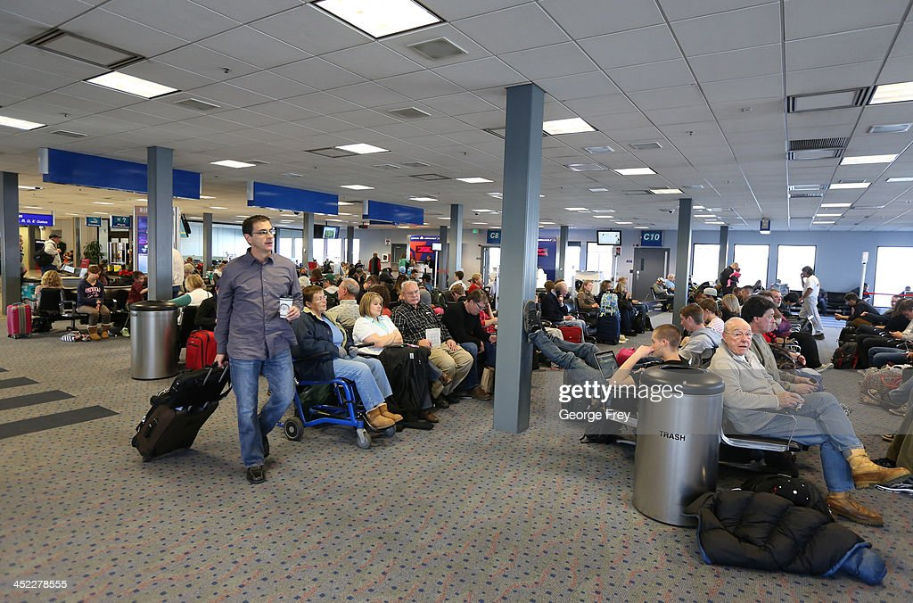 Holiday passengers wait to board their planes at the Salt Lake City international Airport on November 27, 2013 in Salt Lake City, Utah. A wintry storm system that is covering much of the nation is threatening to wreak havoc on holiday travel .