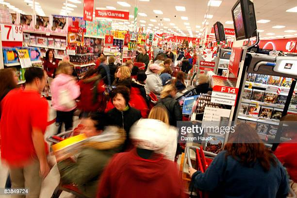 Holiday shoppers race around for gifts after braving the cold temperatures out side of Target as they start the traditional holiday shopping season...