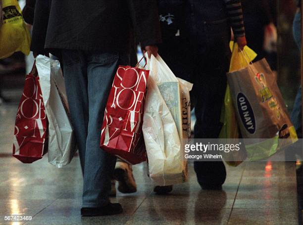 Holiday shopping is in full swing at the Northridge Fashion Center in Northridge Shoppers at Northridge Fashion Center haul bags full of items as...