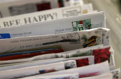 Holiday stamps are seen on mail at the US Post Office sort center on December 18 2014 in San Francisco California The US Postal Service will process...