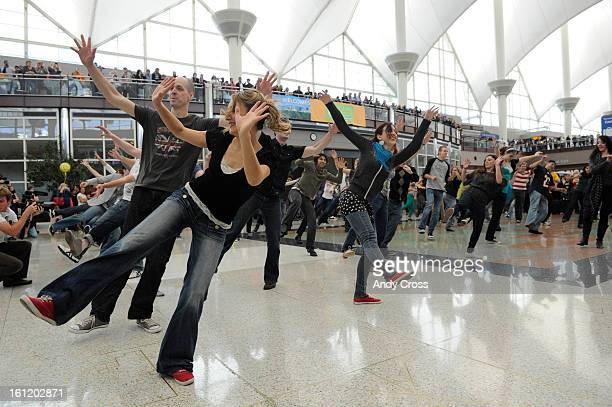 Holiday travelers at Denver International Airport were treated to a flash mob consisting of swing dancers from CommunityMinded Dance at the Jeppesen...
