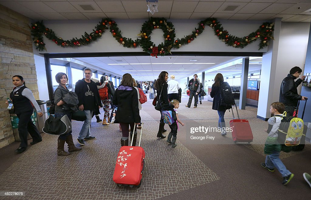 Holiday travelers make their way through the Salt Lake City international Airport on November 27, 2013 in Salt Lake City, Utah. A wintry storm system that is covering much of the nation is threatening to wreak havoc on holiday travel .