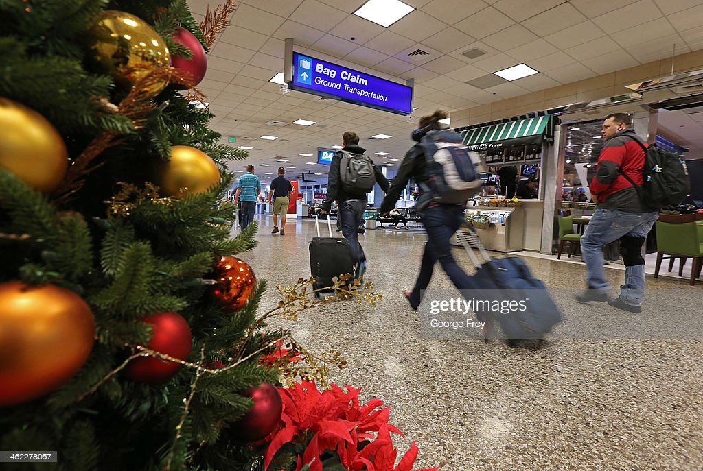 Holiday travelers run through the Salt Lake City international Airport on November 27, 2013 in Salt Lake City, Utah. A wintry storm system that is covering much of the nation is threatening to wreak havoc on holiday travel .