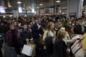 Holiday travelers wait for trains at Penn Station in New York US on Wednesday Nov 27 2013 Heavy rain will fall today from Atlanta to Boston while...