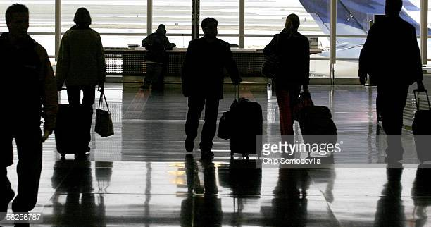 Holiday travelers wanting to beat the rush before Thanksgiving arrive and depart from Ronald Reagan Washington National Airport November 22 2005 in...