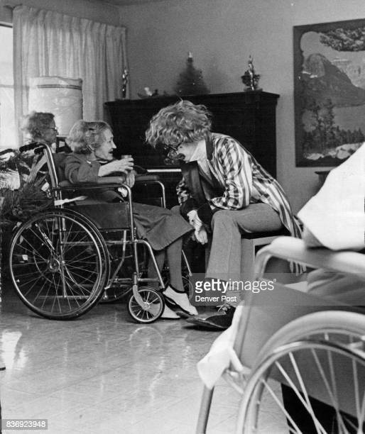 Holiday Visitors Received Mrs Lulu Miles a patient at Garden Manor Nursing Home 115 Ingalls St Lakewood chats with Marlin Fisher who is one of the...