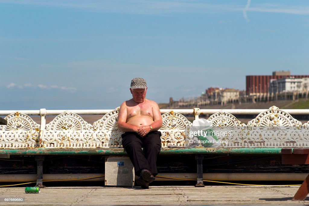 A holidaymaker enjoys the sun on Blackpool's North Pier on June 19, 2017 in Blackpool, England. The UK has officially been put on heatwave alert as the Government issued a level three amber heat warning as temperatures are set to increase. In some parts of the Uk temperatures are expected to peak at 34C.