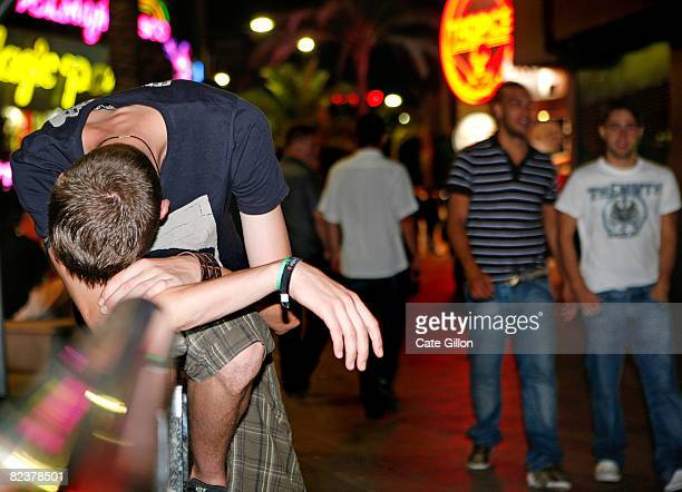 A holidaymaker who has had too much to drink slumps over a barrier on 'The Strip' during a night out on August 16 2008 in Lloret de Mar Spain Feeling...