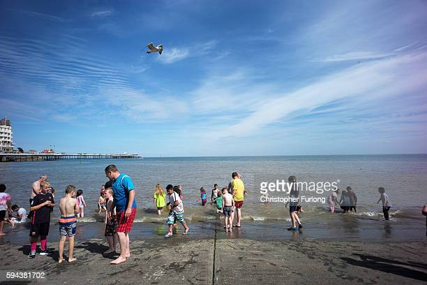 Holidaymakers cool off in the sea as they enjoy the fine weather on the North Wales coast at Llandudno on August 23 2016 in Llandudno Wales As many...