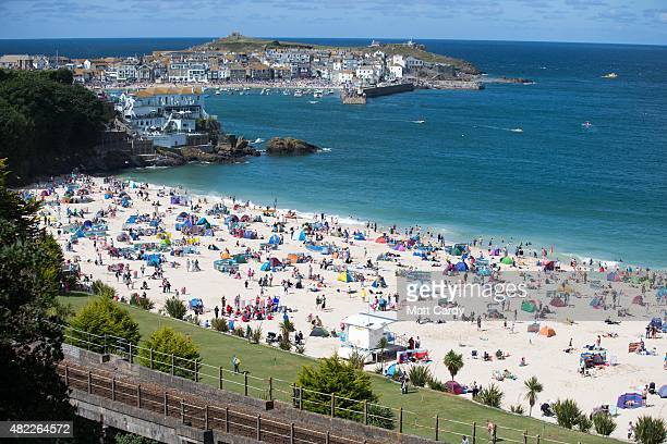 Holidaymakers enjoy the fine sunny weather at Porthminster Beach in St Ives on July 29 2015 in Cornwall England After a unsettled start to the school...