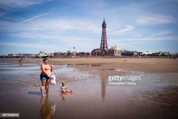 Holidaymakers enjoy the high temperatures on Blackpool beach on June 19 2017 in Blackpool England The UK has officially been put on heatwave alert as...