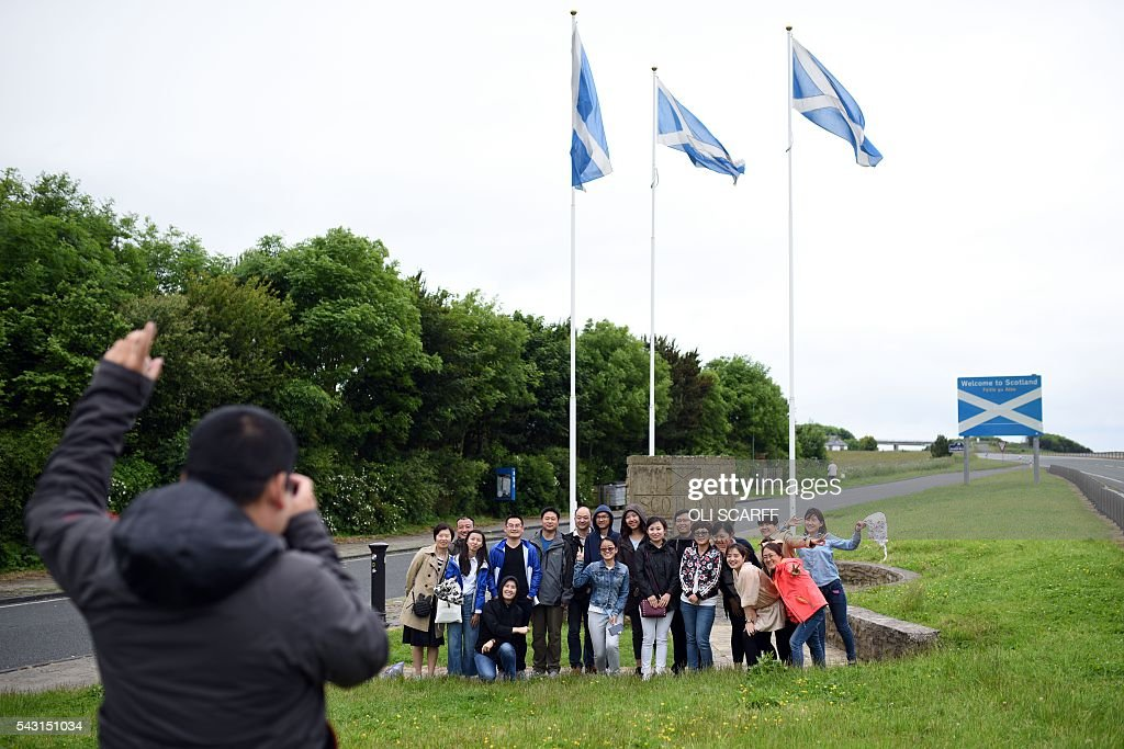 Holidaymakers have their photograph taken at the border between England and Scotland near Berwick-upon-Tweed in northern England close to the border between England and Scotland on June 26, 2016. Scotland's First Minister Nicola Sturgeon campaigned strongly for Britain to remain in the EU, but the vote to leave has given the Scottish National Party leader a fresh shot at securing independence. Sturgeon predicted more than a year ago that a British vote to leave the alliance would give pro-European Scots cause to hold a second referendum on breaking with the UK. SCARFF