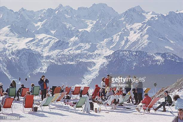 Holidaymakers in sun loungers on the slopes at Verbier Switzerland February 1964