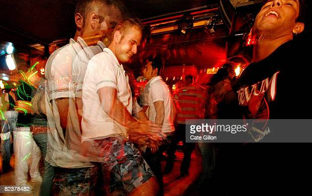 Holidaymakers of various nationalities dancing in a night club on August 16 2008 in Lloret de Mar Spain Feeling the pinch from the credit crunch many...