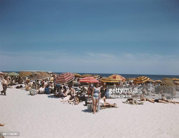 Holidaymakers on Jones Beach Island off the coast of Long Island New York State USA circa 1965