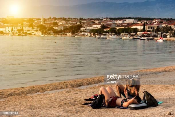 Holiday-makers on the beach, Novalja, Primorsko-Goranska, Croatia