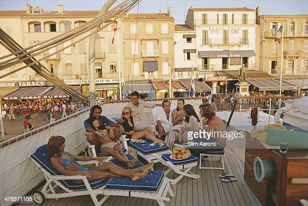 Holidaymakers on the deck of yacht in SaintTropez France August 1971