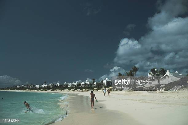 Holidaymakers on the milelong crescent beach at the Hotel Cap Jaluca resort Anguilla Leeward Islands January 1992