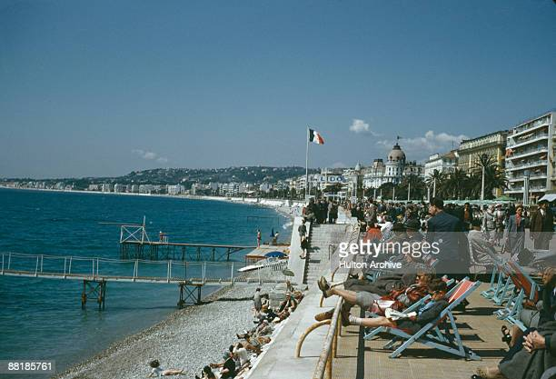 Holidaymakers on the promenade in Nice France circa 1960