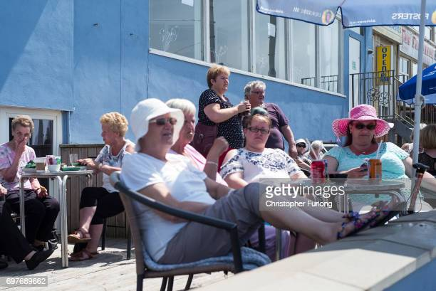Holidaymakers sun themselves on Blackpool Promenade on June 19 2017 in Blackpool England The UK has officially been put on heatwave alert as the...