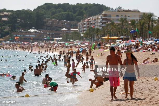 Holidaymakers visit Platja de Lloret which this month is mainly visited by Italian and French tourists on August 14 2008 in Lloret de Mar Spain...