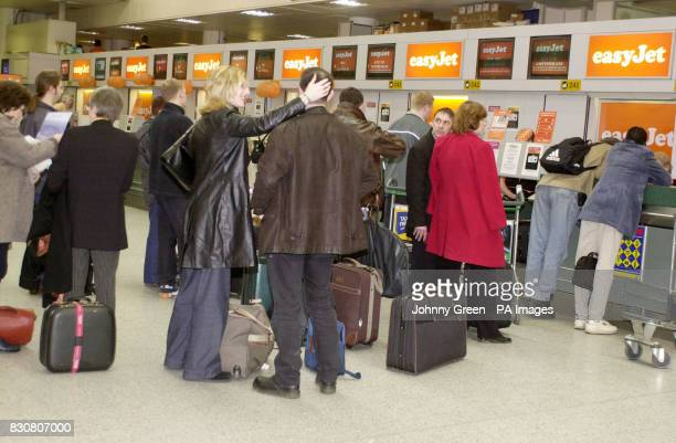 Holidaymakers waiting to book in at easyJet desks at Gatwick Airport south London EasyJet now have eight routes in and out of Gatwick with their...