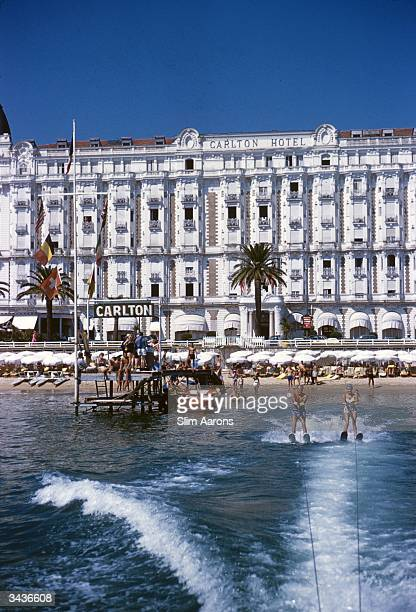 Holidaymakers waterskiing in front of the Carlton Hotel Cannes
