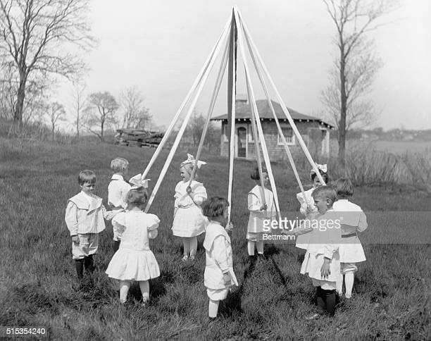 US Holidays and how the children celebrated them May Day Children are shown grouped around a May Pole ready to go Photograph ca 1900 BPA2# 2416