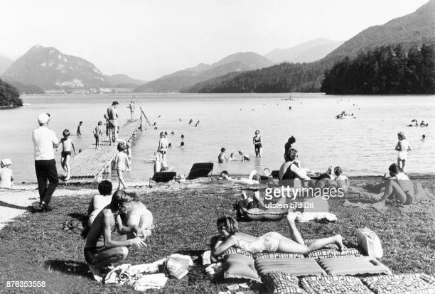 Holidays at Fuschlsee lake in Austria families sitting at the beach