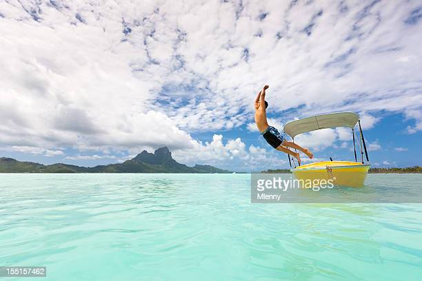 Holidays in Paradise Boy Jumping into Bora-Bora Lagoon