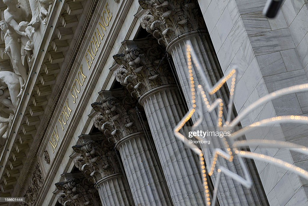 Holidays lights are displayed outside of the New York Stock Exchange (NYSE) in New York, U.S., on Thursday, Dec. 20, 2012. InterContinentalExchange Inc. (ICE), the 12-year-old energy and commodity futures bourse, agreed to acquire NYSE Euronext for cash and stock worth $8.2 billion, moving to take control of the world's biggest equities market. Photographer: Jin Lee/Bloomberg via Getty Images