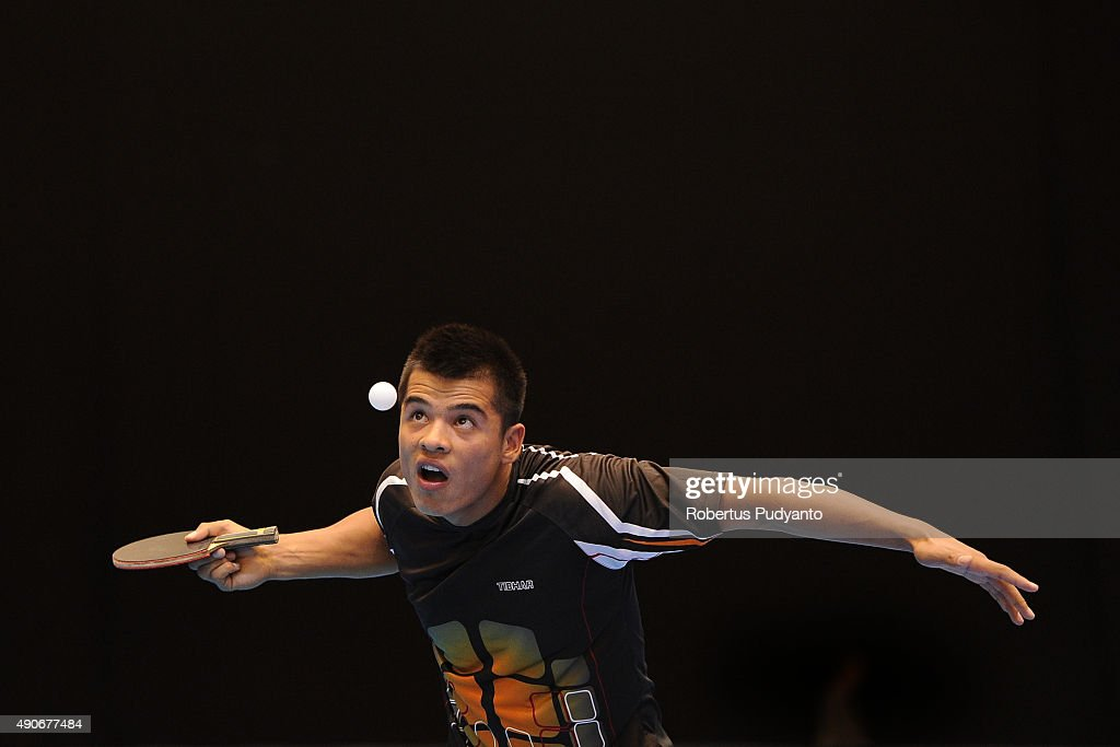 Holikov Elmurod of Uzbekistan competes against Udomsilp Chanakarn of Thailand during Men's singles first round match of the 22nd 2015 ITTF Asian Table Tennis Championships at Pattaya Sports Indoor Stadium on September 30, 2015 in Pattaya, Thailand.
