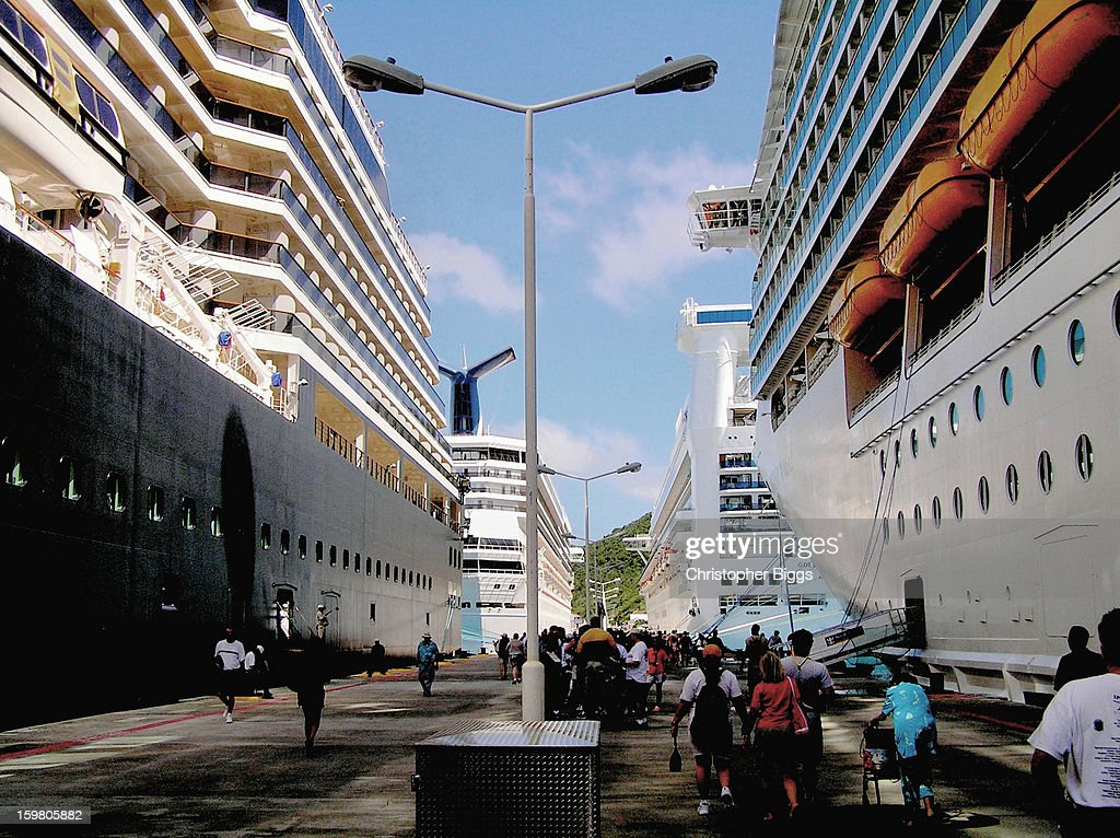 CONTENT] Holland America Line cruise ship Westerdam on left, Carnival Victory forward left, Golden Princess forward right, and Royal Caribbean's Mariner of the Seas on the right, all at the dock in Philipsburg, St Maarten Island, Caribbean.