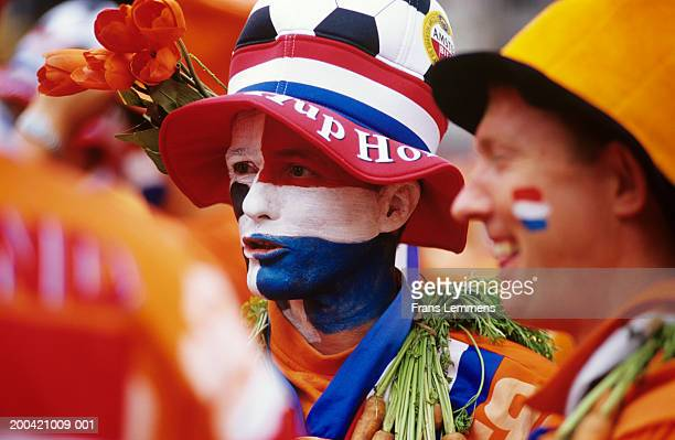 Holland, Amsterdam, football supporters with painted faces, close-up