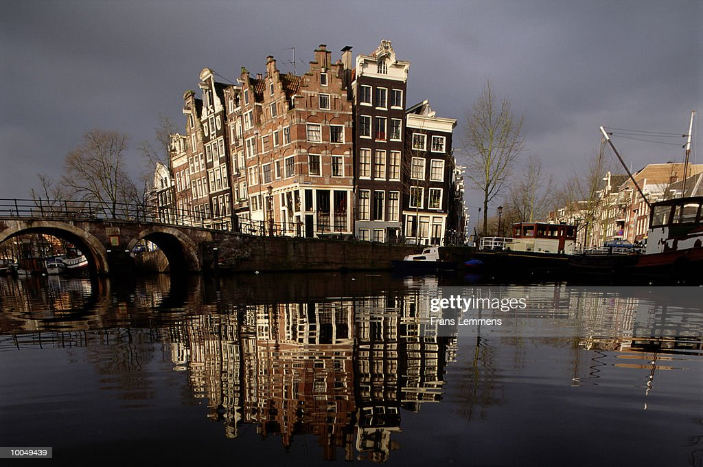 Holland, Amsterdam, Keizersgracht, arches on bridge over canal : Stock Photo