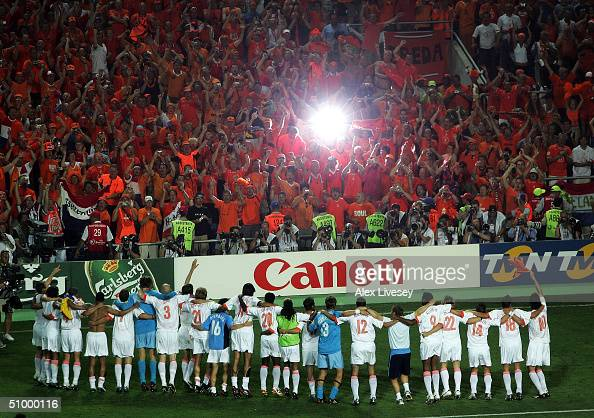 Holland celebrate with their fans after defeating Sweden in the penalty shoot out during the UEFA Euro 2004 Quarter Final match between Sweden and...