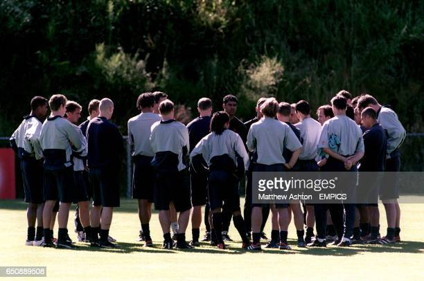 Holland coach Frank Rijkaard talks to his players at their training camp in Hoenderloo