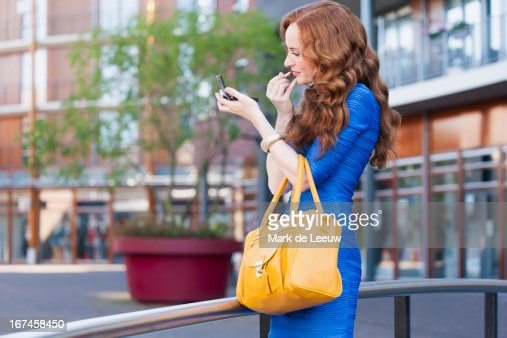 Holland, Goirle, elegant woman improving her make-up : Stock Photo