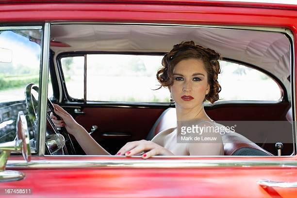 Holland, Goirle, portrait of elegant woman in vintage car