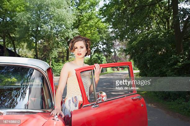 Holland, Goirle, portrait of elegant woman next to vintage car