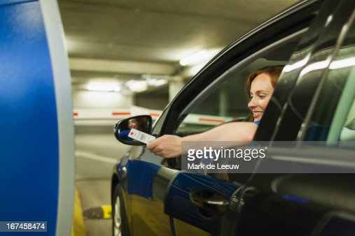 Holland, Goirle, young woman parking car : Stock Photo