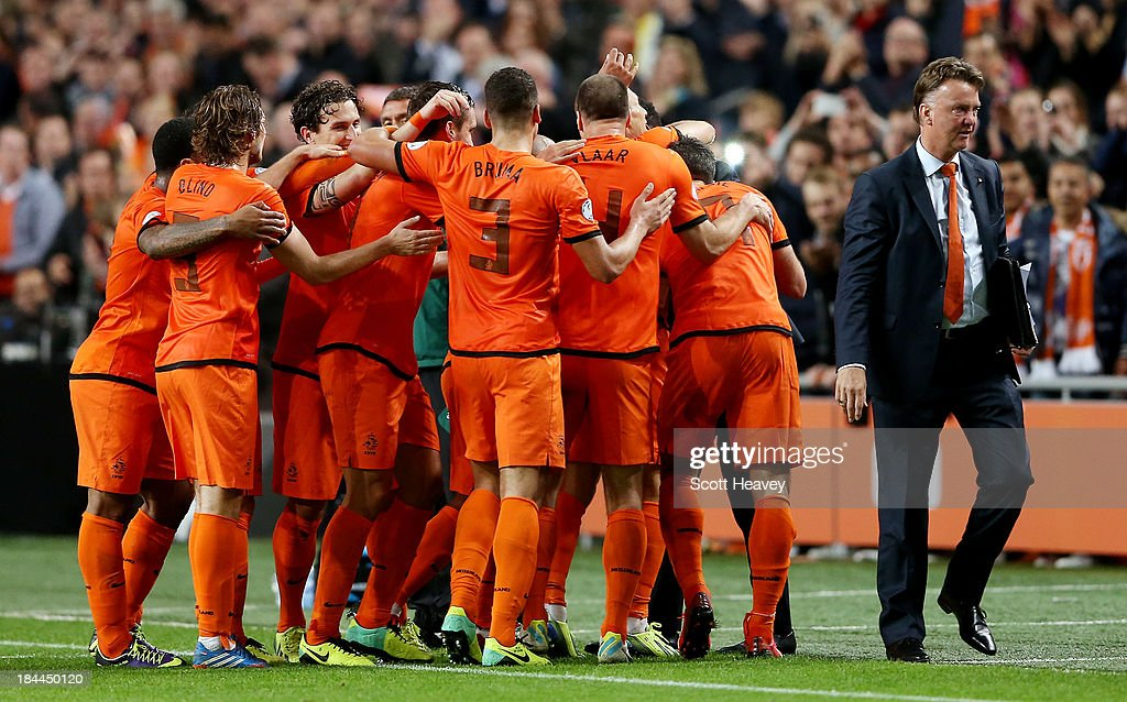 Holland manager Louis van Gaal celebrates with his team during the FIFA 2014 World Cup Qualifing match between Holland and Hungary at Amsterdam Arena on October 11, 2013 in Amsterdam, Netherlands.