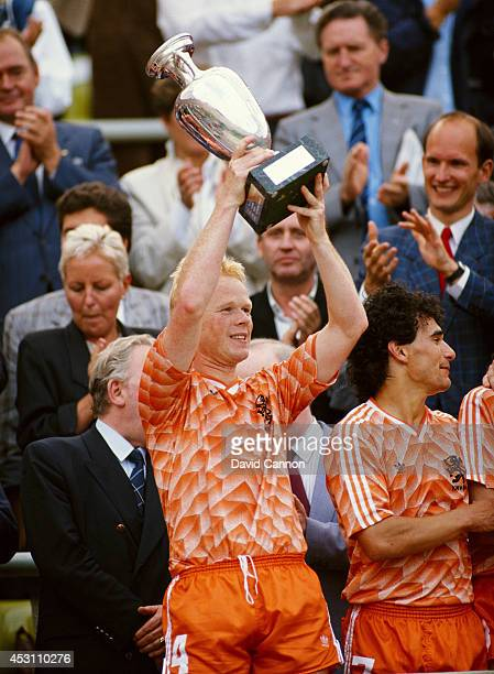 Holland player Ronald Koeman lifts the trophy after the European Championship Final between Holland and USSR at the Olympic Stadium on June 25 1988...