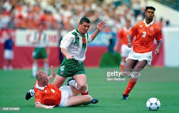 Holland player Ronald Koeman tackles Roy Keane as Frank Rijkaard looks on during the FIFA World Cup match between the Netherlands and Republic of...