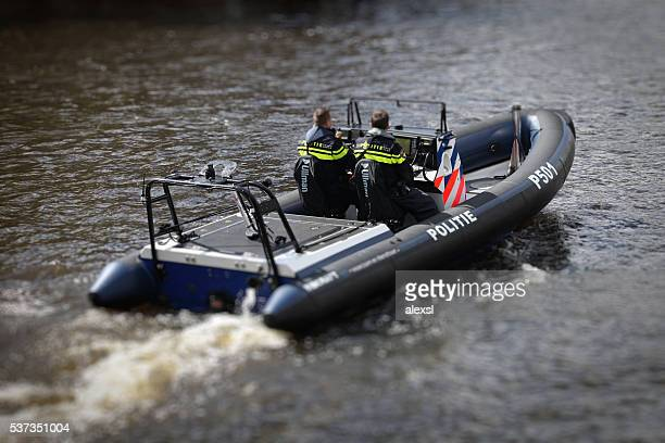 Holland police boat at Amstel river house in Amsterdam