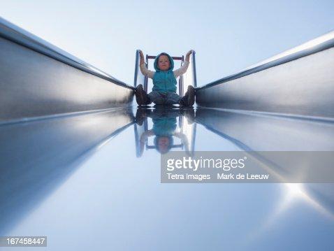 Holland, Tilburg, toddler on slide : Stock Photo