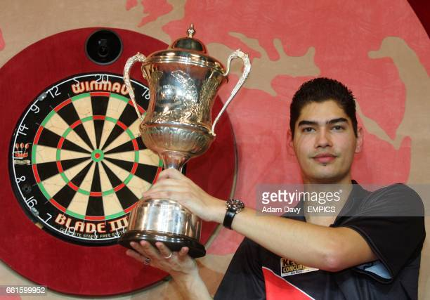 Holland's Jelle Klaasen celebrates with the trophy after beating Raymond van Barneveld