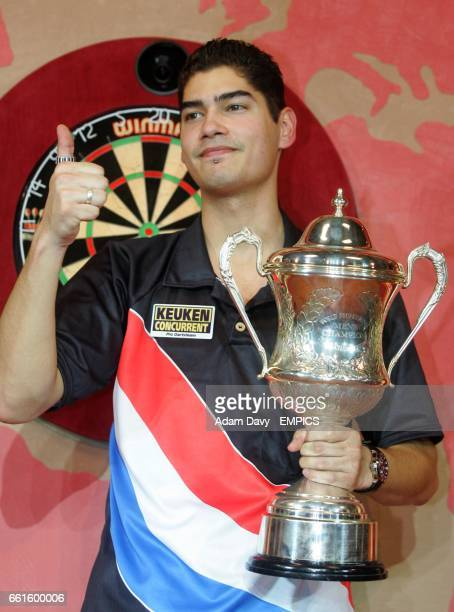 Holland's Jelle Klaasen celebrates with the trophy