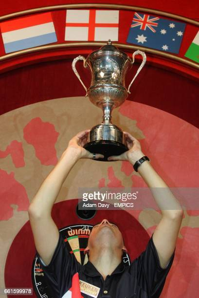 Holland's Jelle Klaasen lifts the trophy as he celebrates beating Raymond van Barneveld